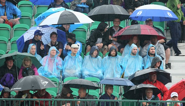 HOYLAKE, ENGLAND - JULY 19: Golf fans endure the elements during the third round of The 143rd Open Championship at Royal Liverpool on July 19, 2014 in...