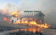 UP IN FLAMES: A house burns in St Francis Bay in the Eastern Cape on Sunday. Up to 100 homes were destroyed, the municipality said