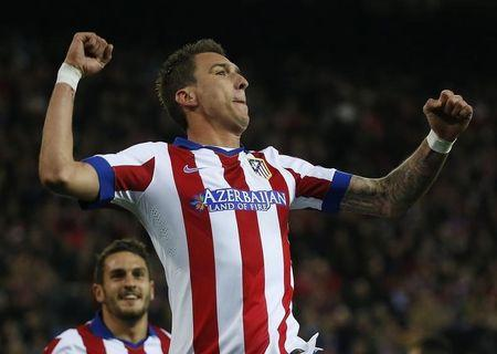 Atletico Madrid's Mario Mandzukic celebrates after scoring a goal against Olympiakos during their Champions League Group A soccer match in Madrid