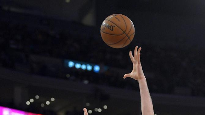Los Angeles Lakers forward Pau Gasol, right, of Spain, shoots as San Antonio Spurs forward Matt Bonner defends during the first half in Game 4 of a first-round NBA basketball playoff series, Sunday, April 28, 2013, in Los Angeles. (AP Photo/Mark J. Terrill)