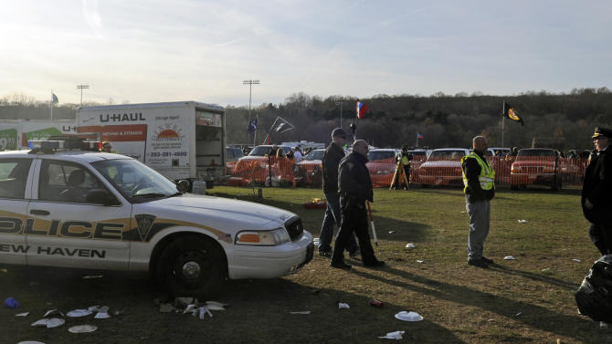 Authorities work the scene where the driver of a rental truck carrying beer kegs through a parking area before an NCAA college football game between Yale and Harvard suddenly accelerated, fatally striking a 30-year-old woman and injuring two other women, police said, Saturday, Nov. 19, 2011, in New Haven, Conn. (AP Photo/Bob Child)