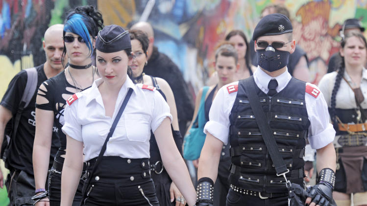 Participants of the Wave Gothic Festival walk in Leipzig, eastern Germany, on Friday, June 10, 2011. The meeting  is supposed to be  the world's largest festival for 'dark culture'. For several days, Leipzig has become a real gothic paradise – white makeup, bold-up eyes, black hair and incredible outfits. (AP Photo/Jens Meyer)