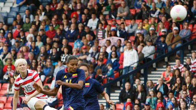 United States' Megan Rapinoe, left, shoots and scores the opening goal during the group G women's soccer match between the United States and Colombia at the London 2012 Summer Olympics, Saturday, July 28, 2012, at Hampden Park Stadium in Glasgow, Scotland. (AP Photo/Chris Clark)