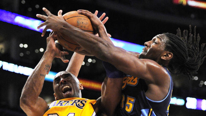 Denver Nuggets forward Kenneth Faried, right, ties up Los Angeles Lakers guard Kobe Bryant during the first half in Game 5 of an NBA first-round playoff basketball game, Tuesday, May 8, 2012, in Los Angeles. (AP Photo/Mark J. Terrill)