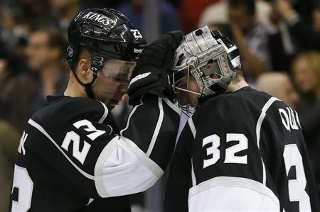 Los Angeles Kings Brown celebrates with Quick after defeating the Calgary Flames during their NHL game in Los Angeles