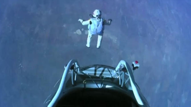This image made from video, provided by Red Bull Stratos shows pilot Felix Baumgartner of Austria as he jumps out of the capsule during the final manned flight for Red Bull Stratos on Sunday, Oct. 14, 2012. In a giant leap from more than 24 miles up, Baumgartner shattered the sound barrier Sunday while making the highest jump ever — a tumbling, death-defying plunge from a balloon to a safe landing in the New Mexico desert. (AP Photo/Red Bull Stratos)