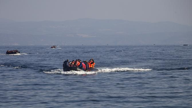 Refugees and migrants are seen onboard eight dinghies as they cross a part of the Aegean Sea from the Turkish coast to reach the Greek island of Lesbos