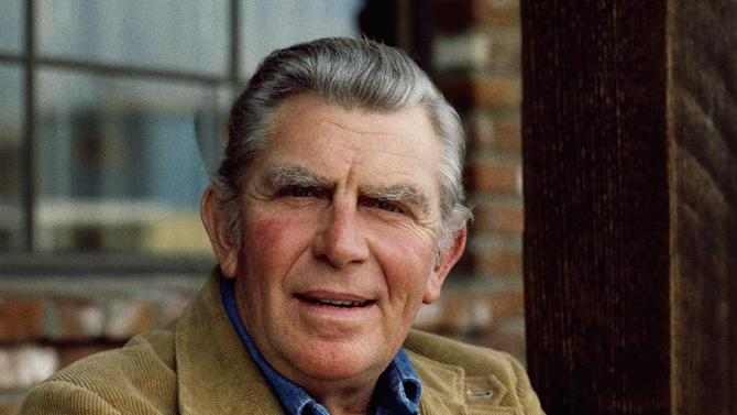 """FILE - This Jan. 1983 file photo shows actor Andy Griffith posing in Los Angeles to promote his upcoming CBS-TV film, """"Murder in Coweta County"""". Griffith, whose homespun mix of humor and wisdom made """"The Andy Griffith Show"""" an enduring TV favorite, died Tuesday, July 3, 2012 in Manteo, N.C. He was 86. (AP Photo/Wally Fong, file)"""