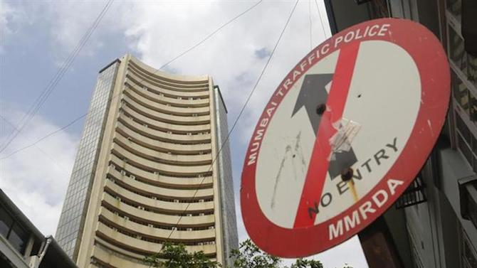 A road sign is seen next to Bombay Stock Exchange (BSE) building in Mumbai August 22, 2013. REUTERS/Danish Siddiqui