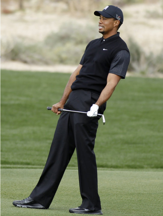 Woods reacts on 5th against Howell at the WGC-Accenture Match Play golf in Marana, Arizona