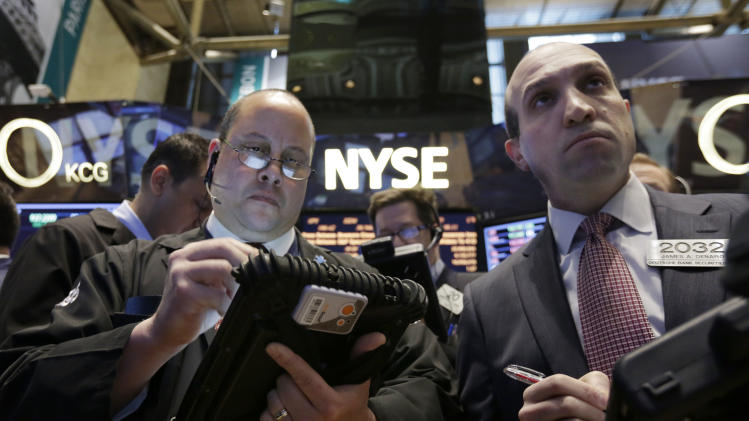 In this Wednesday, March 12, 2014, photo, traders Jeffrey Vazquez, left, and James Denaro work on the floor of the New York Stock Exchange. Most global stock markets fell sharply Friday March 14, 2014 over persistent concerns about weakness in the Chinese economy and tensions in Ukraine. (AP Photo/Richard Drew)