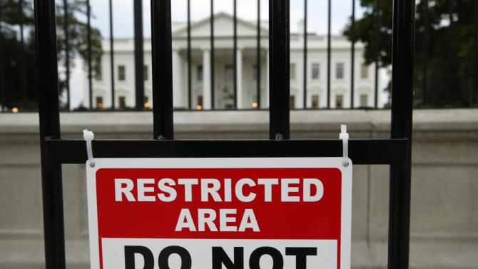 File photo of a sign posted on a fence outside the White House in Washington