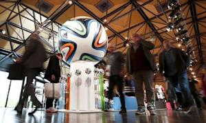 Shareholders of Adidas, world's second largest sports apparel firm, arrive for company annual general meeting in Fuerth