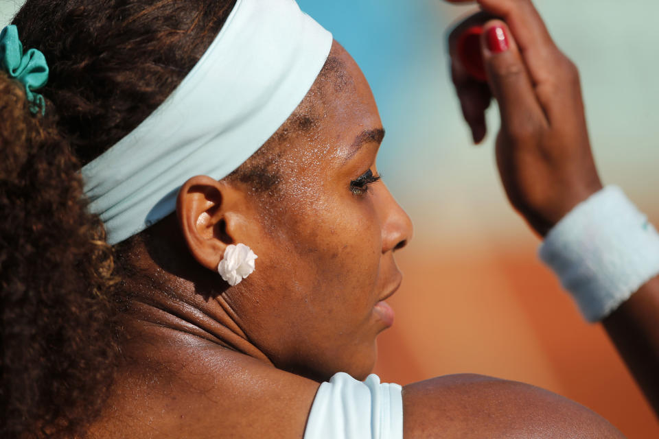 USA's Serena Williams sits during a break as she plays France's Virginie Razzano during their first round match in the French Open tennis tournament at the Roland Garros stadium in Paris, Tuesday, May 29, 2012. (AP Photo/Christophe Ena)