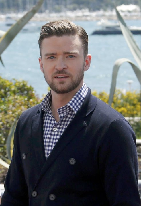 Cast member Justin Timberlake leaves after a photocall for the film 'Inside Llewyn Davis' during the 66th Cannes Film Festival