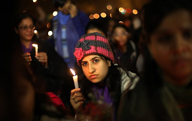 Indians participate in a candle lit vigil to mourn the death of a gang rape victim in New Delhi, India , Saturday, Dec. 29, 2012. Indian police charged six men with murder on Saturday, adding to accus