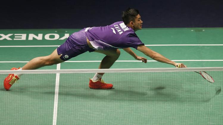 China's Wang tries to hit a return to Thailand's Boonsak during their men's single match at the Malaysia BWF world superseries finals 2013 in Kuala Lumpur