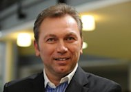 Lance Armstrong's former team manager Johan Bruyneel, pictured in February 2012, will fight his case in arbitration rather than accept penalties for allegedly engaging in a long-running doping conspiracy, the US Anti-Doping Agency said Friday