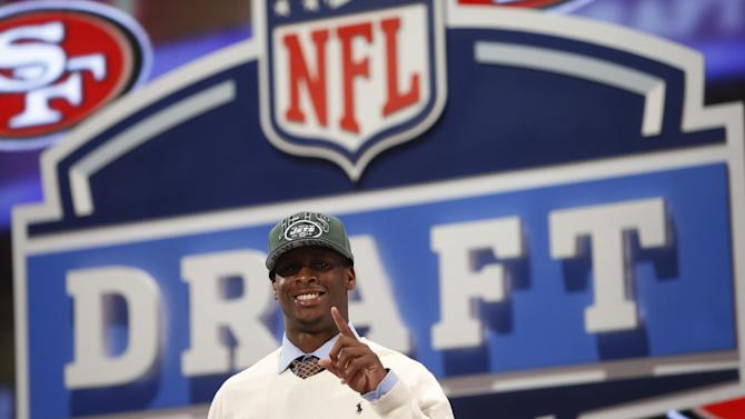Geno Smith, a quarterback from West Virginia  gestures after being selected 39th overall by the New York Jets in the second round of the NFL Draft, Friday, April 26, 2013 at Radio City Music Hall in New York., Friday, April 26, 2013 at Radio City Music Hall in New York.  (AP Photo/Jason DeCrow)