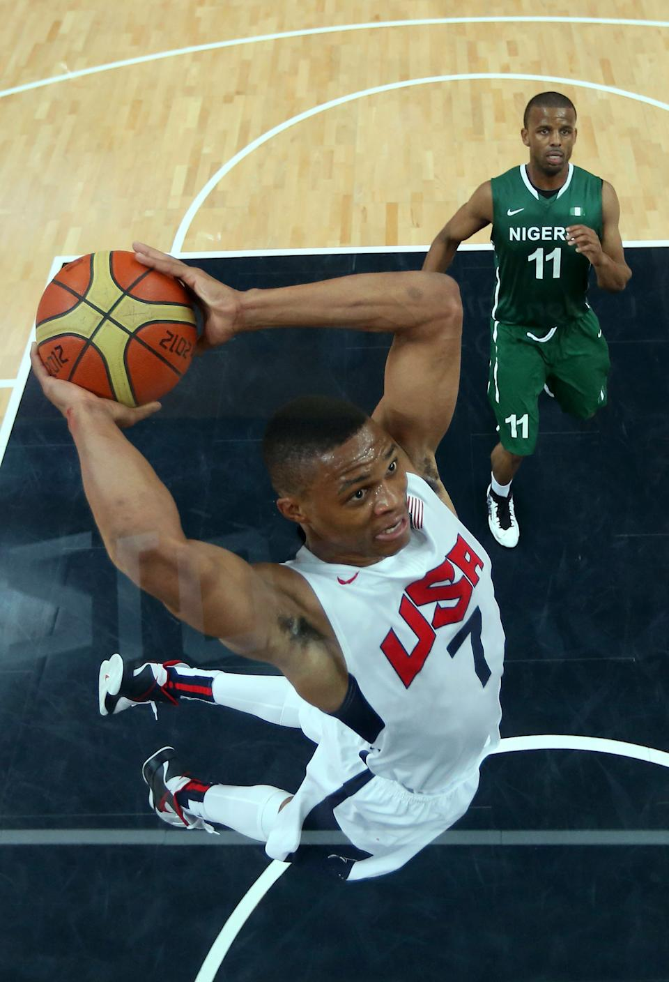 Russell Westbrook (7) of the United States shoots against Richard Oruche (11) of Nigeria during their men's basketball preliminary round match at the 2012 Summer Olympics on Thursday, Aug. 2, 2012, in London. (AP Photo/Christian Petersen, Pool)