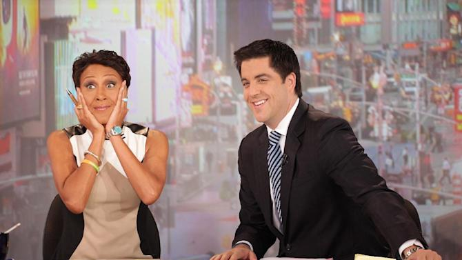 """This image released by ABC shows """"Good Morning America"""" co-host Robin Roberts, left, and co-host Josh Elliott on the popular morning show on Thursday, Aug. 30, 2012 in New York. Roberts has said goodbye to """"Good Morning America,"""" but only for a while. The """"GMA"""" anchor made her final appearance Thursday before going on medical leave for a bone marrow transplant. Roberts' departure was first planned for Friday, but she chose to exit a day early to visit her ailing mother in Mississippi. In July she first disclosed that she has MDS, a blood and bone marrow disease. She will be hospitalized next week to prepare for the transplant. The donor will be her older sister, Sally-Ann Roberts. (AP Photo/ABC, Fred Lee)"""