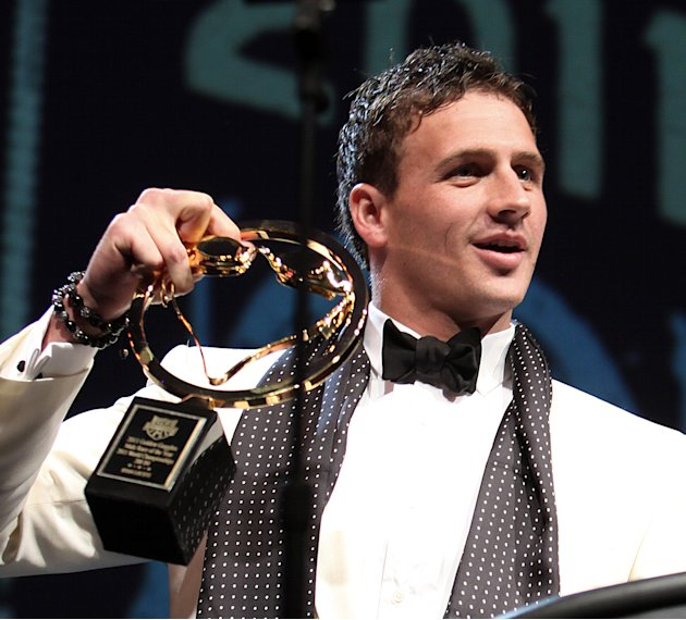 After knocking the award off the  podium and grabbing it before it hit the floor, Ryan Lochte holds the award for best male race of the year at the USA Swimming Foundation's Golden Goggle awards in Lo
