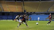 : Boca Juniors&#39; midfielder Lautaro Acosta (L) vies for the ball with Colon&#39;s forward Ricardo Gomez in an empty stadium (AFP)