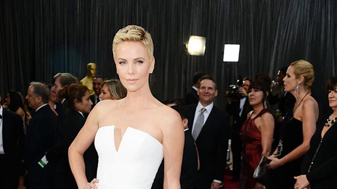 Anne Hathaway, eat your heart out. Charlize Theron rocks a pixie cut (she shaved her head for a role in 'Mad Max'), which is one of the hardest haircuts to pull off. The short 'do complements the stunning two-piece white gown.