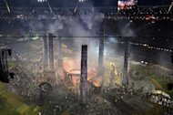Actors perform in the scene The Age of Industry during the opening ceremony of the London 2012 Olympic Games at the Olympic Stadium in London