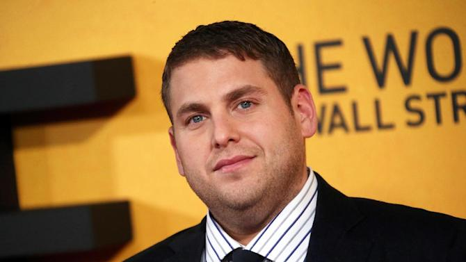 "FILE - This Jan. 9, 2014 file photo shows U.S actor Jonah Hill at the UK Premiere of ""The Wolf Of Wall Street,"" at a Leicester Square cinema in central London. Hill has apologized for shouting a homophobic slur at a paparazzo in an encounter caught on video. A video posted Tuesday, June 3, by TMZ shows a photographer pestering Hill, who responded with expletives and an anti-gay expression. On ""The Howard Stern Show"" on Tuesday, the 30-year-old actor acknowledged that he said ""a disgusting word."" Hill said the word ""does not at all reflect how I feel about any group of people."" He said that he's been a gay-rights activist ""from the day I was born."" Earlier this year, Hill promoted a Human Rights Campaign effort opposing anti-gay laws in Russia ahead of the Winter Olympics. Hill said he had been harassed by the photographer, claiming he said ""hurtful things about my family, really hurtful things about me personally."" (Photo by Joel Ryan/Invision/AP, File)"