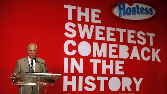 """CEO of Hostess Brands Dean Metropoulos speaks at a ceremony marking the return of """"Twinkies"""" at a plant in Schiller Park, Illinois"""
