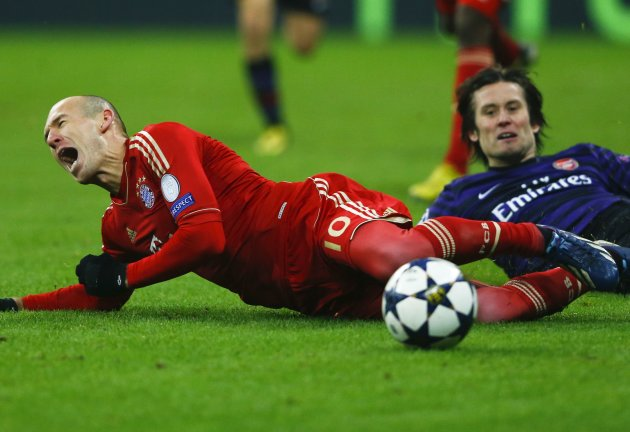 Bayern Munich's Robben screams after being fouled by Arsenal's Rosicky during their Champions League round of 16 second leg match in Munich
