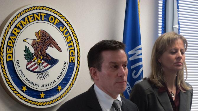 U.S. Attorney James Santelle and FBI special agent in charge Teresa Carlson meet with reporters Tuesday, May 28, 2013, to explain why no federal charges would be brought against three Milwaukee police officers in whose custody a gasping man died in 2011. Santelle said there wasn't enough evidence for him to prove the officers had specific intent to deprive Derek Williams, 22, of his rights, and that simple negligence or poor judgment was not sufficient. (AP Photo/Dinesh Ramde)