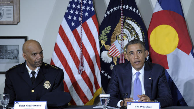 President Barack Obama, sitting next to Denver Police Chief Robert White, participates in a meeting at the Denver Police Academy in Denver, Colo., with local law enforcement officials and community leaders to discuss the state's new measures to reduce gun violence, Wednesday, April 3, 2013. (AP Photo/Susan Walsh)
