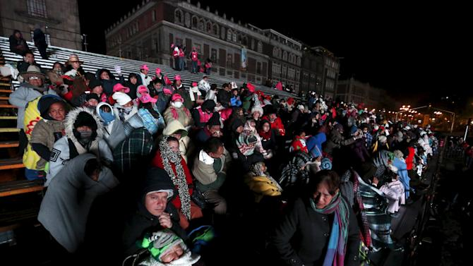 Parishioners await the arrival of Pope Francis to Zocalo square in Mexico City
