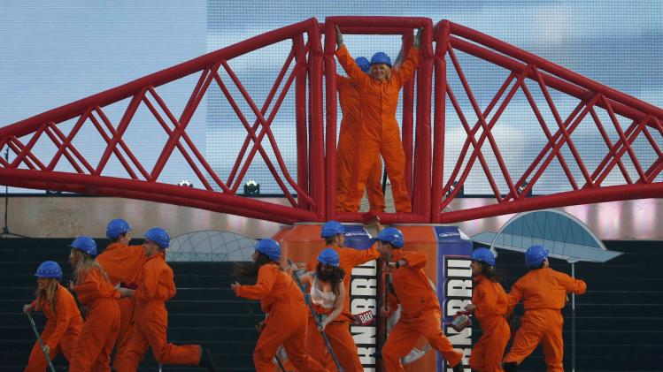 Performers take part in the opening ceremony for the 2014 Commonwealth Games at Celtic Park in Glasgow
