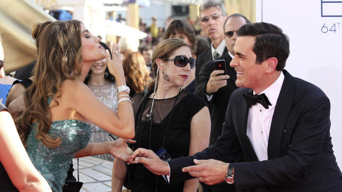 "Sofia Vergara, left, and Ty Burrell, right, of ""Modern Family"" arrive at the 64th Primetime Emmy Awards at the Nokia Theatre on Sunday, Sept. 23, 2012, in Los Angeles. (Photo by Matt Sayles/Invision/AP)"