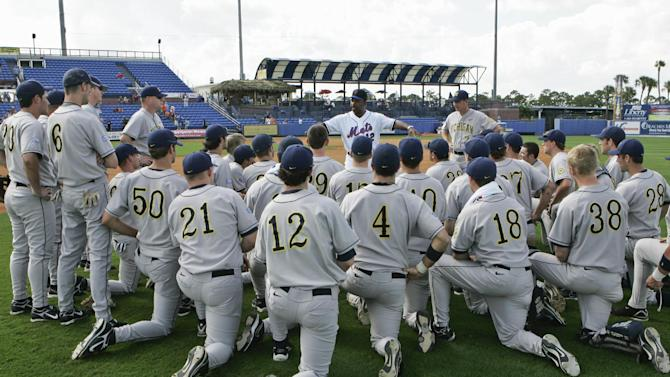 FILE - This file photo from Feb. 26, 2008, shows New York Mets manager Willie Randolph, center rear, addressing Michigan's NCAA college baseball players with Michigan's head coach Rich Maloney (2), following a baseball spring training game, in Port St. Lucie, Fla. Major League Baseball might provide scholarships and exert greater influence over Division I college baseball if a proposed partnership with the NCAA becomes reality. A spokesman for MLB, the head of the players union and the NCAA confirmed preliminary discussions have been held, most recently last month in New York. (AP Photo/Nati Harnik, File)