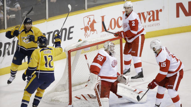 Nashville Predators forward Mike Fisher (12) celebrates with Matt Cullen (7) after Fisher scored a goal against Detroit Red Wings goalie Jonas Gustavsson (50), of Sweden, in the second period of an NHL hockey game Saturday, Feb. 28, 2015, in Nashville, Tenn. (AP Photo/Mark Humphrey)