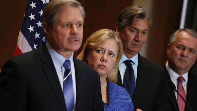 Canada's Ambassador to the US Gary Doer, second right, stands with Sen. Mary Landrieu, D-La., second left, Sen. John Hoeven, R-N.D., left, and American Petroleum Institute (API) President and CEO Jack N. Gerard, right, during a news conference on Capitol Hill in Washington, Tuesday, Feb. 4, 2014, regarding the approval of the Keystone XL pipeline. (AP Photo/Charles Dharapak)
