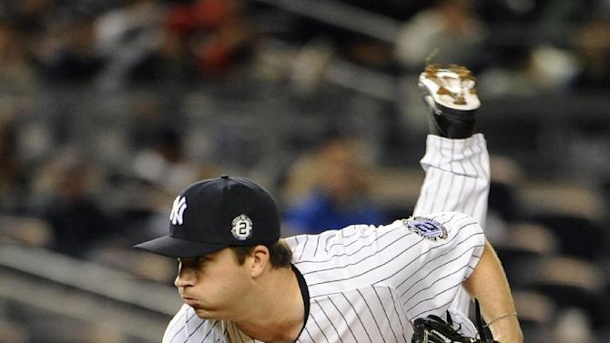 New York Yankees relief pitcher Adam Warren pitches in the ninth inning against the Toronto Blue Jays in a baseball game at Yankee Stadium on Friday, Sept. 19, 2014, in New York. The Yankees won 5-3. (AP Photo/Kathy Kmonicek)