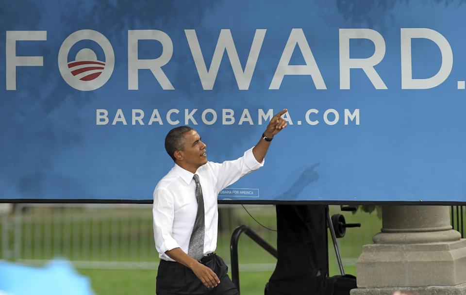 President Barack Obama walks to the podium before speaking at a campaign event at Schiller Park Monday, Sept. 17, 2012, in Columbus, Ohio. (AP Photo/Tony Dejak)