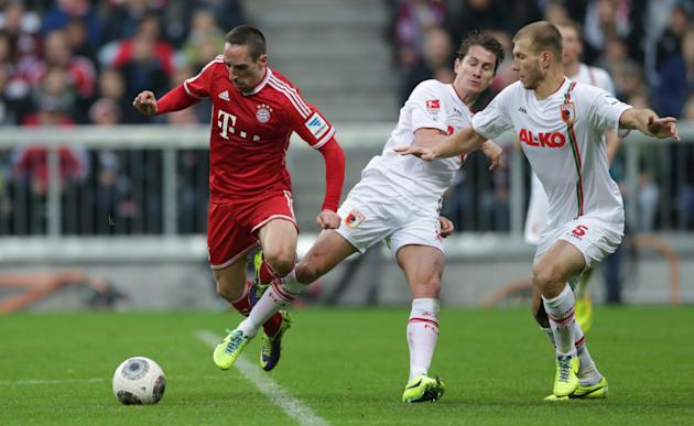 Augsburg's Paul Verhaegh of the Netherlands, 2nd right, fouls Bayern's Franck Ribery of France during the German first division Bundesliga soccer match between FC Bayern Munich and FC Augsburg, in Mun