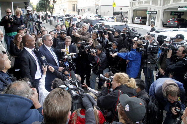 Barry Bonds, left, and his attorney Allen Ruby face the media outside a federal court building Wednesday, April 13, 2011, in San Francisco. The former baseball player was convicted of one count of obs