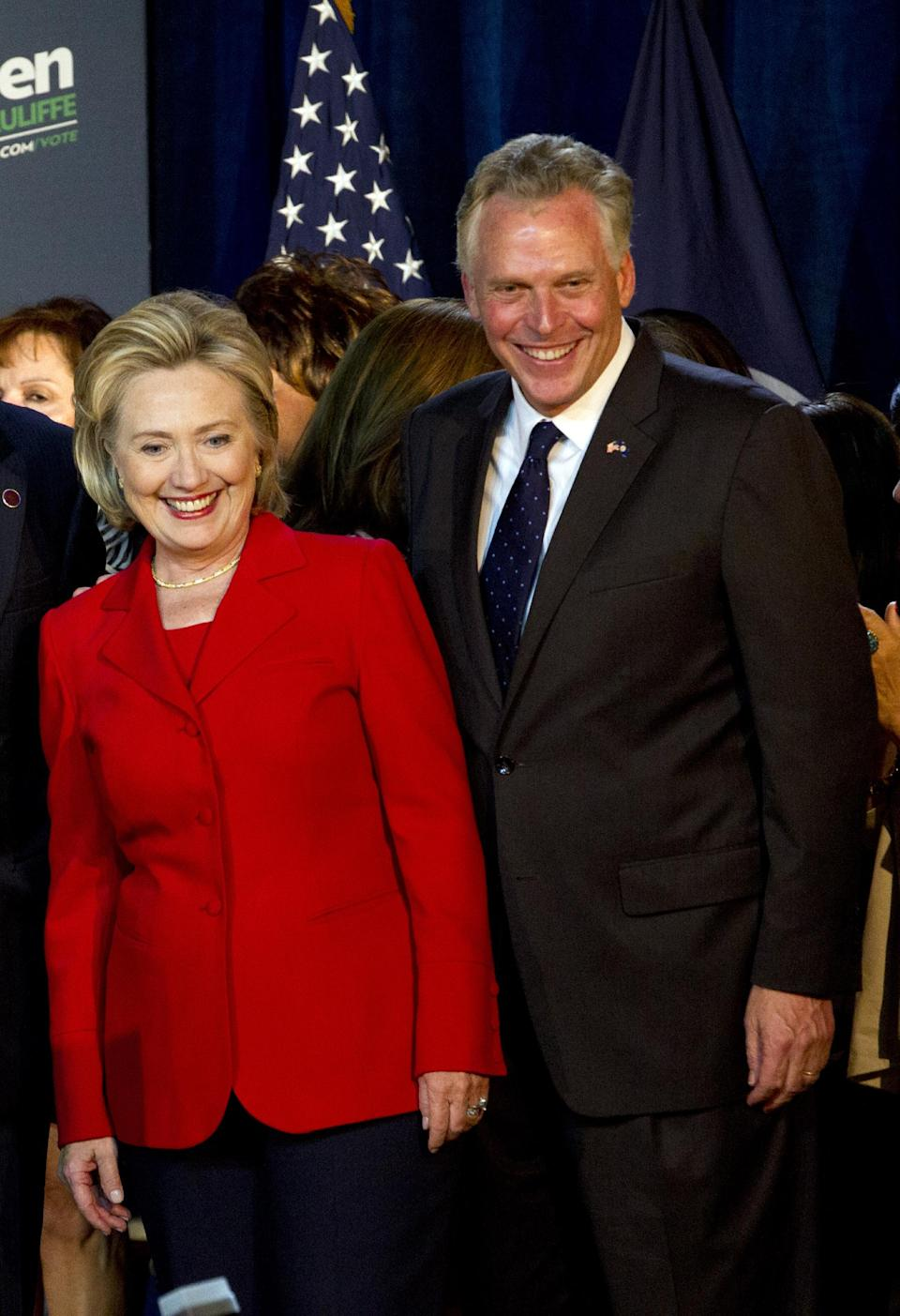 Virginia gubernatorial candidate, Democrat Terry McAuliffe, right, and former Secretary of State Hillary Rodham Clinton look to the crowd during a campaign rally, Women for Terry, at the State Theater in Falls Church, Va. on Saturday, Oct. 19, 2013. Clinton formally endorsed her family friend's bid for Virginia governor, marking her first public campaign event since departing the State Department in February. ( AP Photo/Jose Luis Magana)