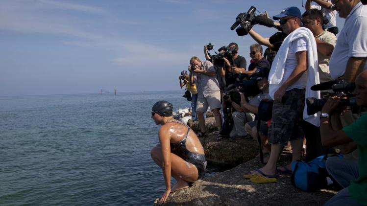 Australian swimmer Chloe McCardel prepares to jump into the water at Hemingway Marina to start her swim to Florida from Havana, Cuba, Wednesday, June 12, 2013. McCardel, 29, is bidding to become the first person to make the Straits of Florida crossing without the protection of a shark cage. American Diana Nyad and Australian Penny Palfrey have attempted the crossing four times between them since 2011, but each time threw in the towel part way through due to injury, jellyfish stings or strong currents. Australian Susie Maroney did it in 1997, but with a shark cage. (AP Photo / Ramon Espinosa)