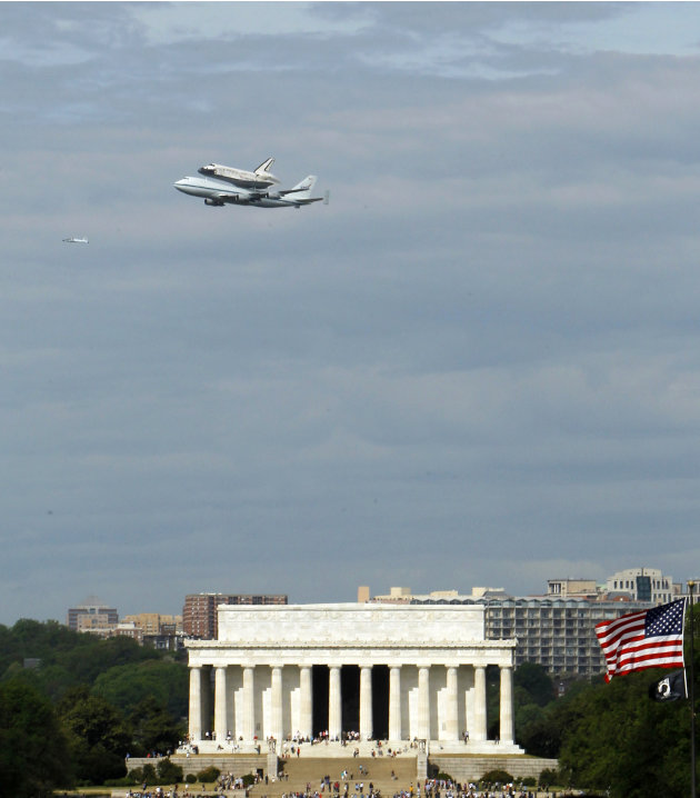 The Space Shuttle Discovery, mounted on the Shuttle Carrier Aircraft, flies over the Lincoln Memorial in Washington, Tuesday, April 17, 2012. Discovery is en route from Kennedy Space Center to the Smi