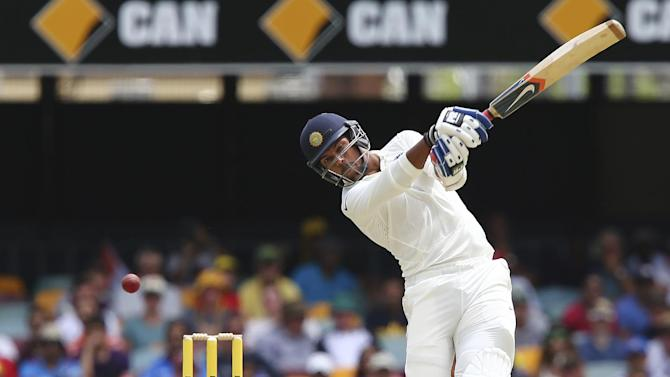 India's Umesh Yadav plays a shot during their play on day four of the second cricket test in Brisbane, Australia, Saturday, Dec. 20, 2014. (AP Photo/Tertius Pickard)