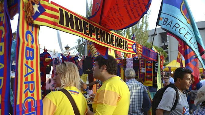 """FILE- In this Oct. 7, 2012, file photo, supporters of Barcelona before a Spanish La Liga soccer match against  Real Madrid at the Camp Nou Stadium, in Barcelona, Spain. More than ever, FC Barcelona, known affectionately as Barca, lived up to its motto of being """"more than a club"""" for this wealthy northeastern region where Spain's economic crisis is fueling separatist sentiment. Barca has been seen as a bastion of Catalan identity dating back to the three decades of dictatorship when Catalans could not openly speak, teach or publish in their native Catalan language. Barcelona writer Manuel Vazquez Montalban famously called the football team """"Catalonia's unarmed symbolic army."""" (AP Photo/Manu Fernandez, File)"""