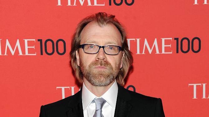"FILE - This April 23, 2013 file photo shows writer George Saunders at the TIME 100 Gala celebrating the ""100 Most Influential People in the World"" in New York. Saunders was named a National Book Awards finalist for fiction on Thursday, Sept. 19. (Photo by Evan Agostini/Invision/AP, File)"